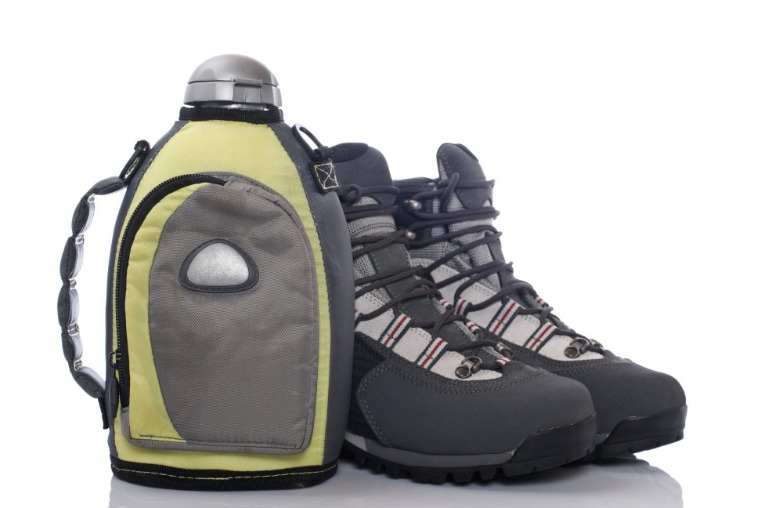 water canteen and hiking boots | Asheville Connections