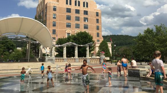 Kids playing in water at Splashville at Pack Square Park | Asheville Connections