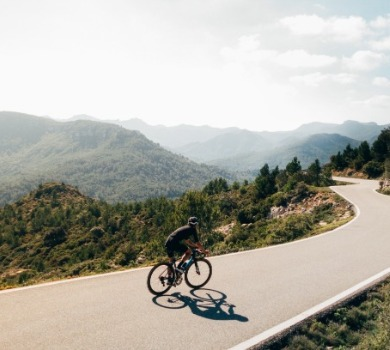 cyclist enjoying the mountains | Asheville Connections