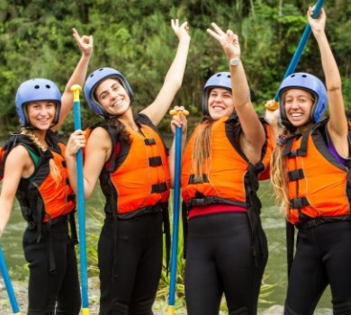 girls wearing life vests before white water rafting | Asheville Connections
